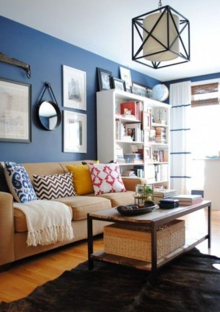13-brown-and-beige-furniture-a-bold-blue-accent-wall-for-an-eye-catchy-look