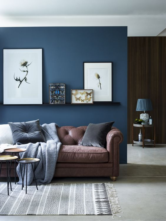 14-chic-seating-area-with-a-brown-sofa-and-a-navy-accent-wall-and-textiles