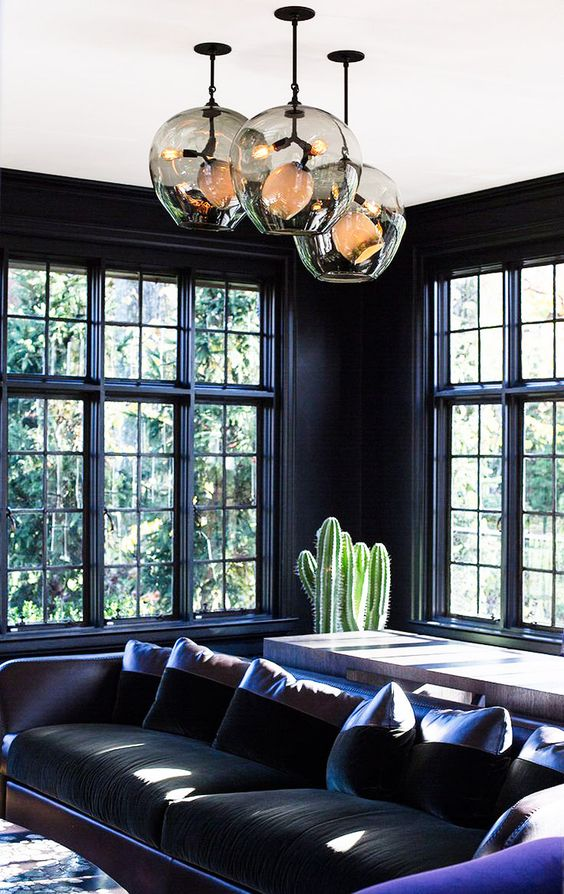 14-dark-hued-room-with-purple-accents-cact-and-unique-pendants