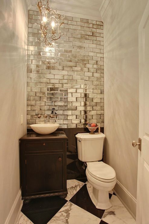 16-mirrored-subway-tiles-create-a-bold-accent-and-reflect-the-light-making-the-space-bigger