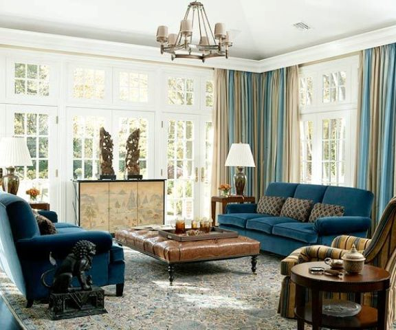 16-navy-blue-upholstery-blue-and-beige-draperies-beige-room-decor-and-a-rich-brown-leather-ottoman