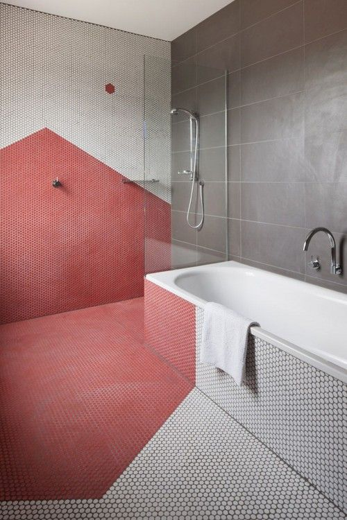 16-penny-tiles-create-a-geometric-pattern-in-a-different-shade-on-the-wall-and-floor
