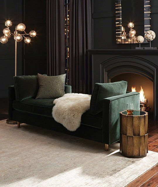 16-soft-black-living-room-with-a-dark-green-sofa-art-deco-lights-and-a-working-fireplace