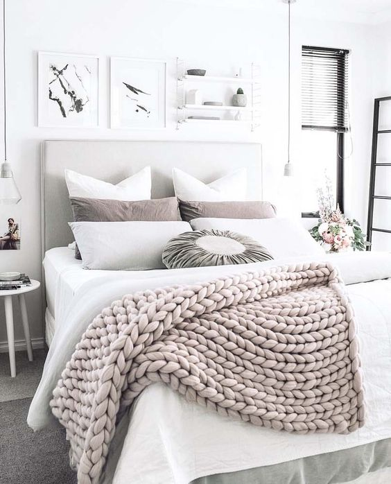 17-a-chunky-knit-wool-throw-adds-texture-and-interest-to-this-neutral-bedroom