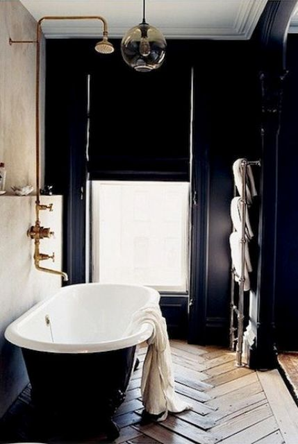 17-elegant-art-deco-bathroom-with-a-window-for-a-view-and-a-parquet-floor