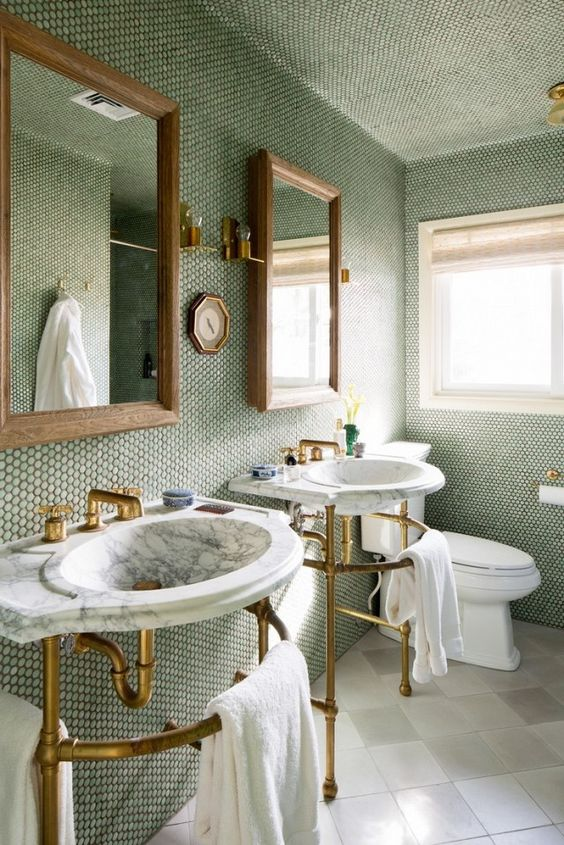 19-bathroom-with-brass-and-marble-fixtures-and-a-wall-of-moss-green-penny-tiles