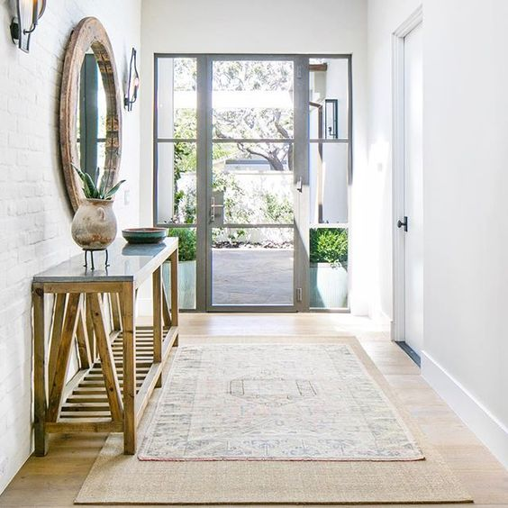 19-beautiful-rustic-entry-with-steel-frame-doors-a-round-reclaimed-wood-mirror-a-white-brick-wall