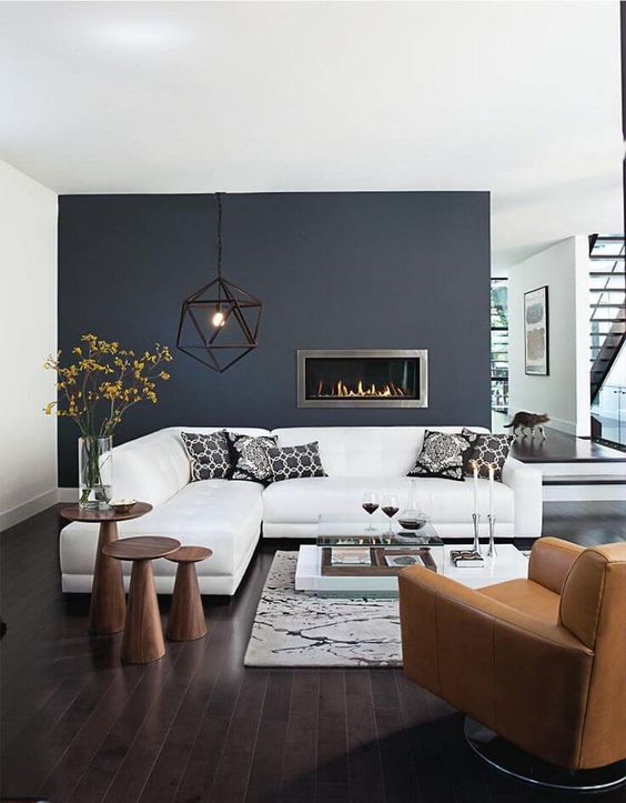21-highlight-the-fireplace-with-a-dark-grey-acent-wall-in-a-neutral-living-room
