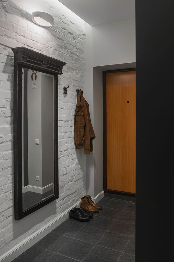21-laconic-bachelor-entryway-with-a-white-brick-wall