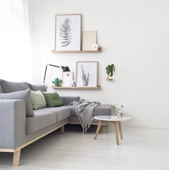 21-light-grey-sofa-with-green-touches-and-botanical-decorations