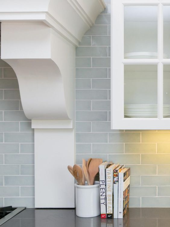 22-subway-tiles-in-a-pale-blue-gray-give-depth-to-the-backsplash-and-make-the-white-cabinetry-feel-even-more-fresh