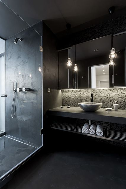 23-black-modern-bathroom-with-a-concrete-countertop-and-a-tiled-shower