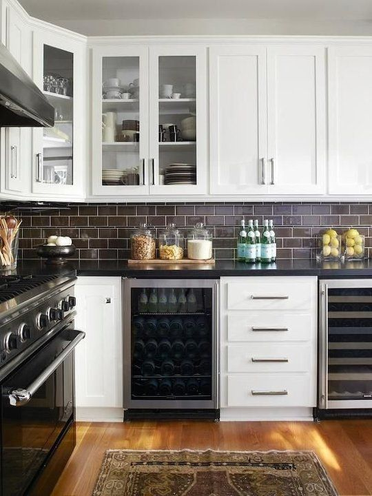 23-chocolate-brown-subway-tiles-look-chic-with-black-stone-countertops-and-white-cabinetry