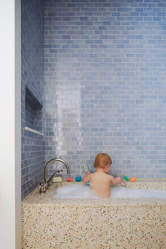 23-watery-blue-subway-tiles-and-a-terrazzo-bath-look-so-contrasting-and-cool-together