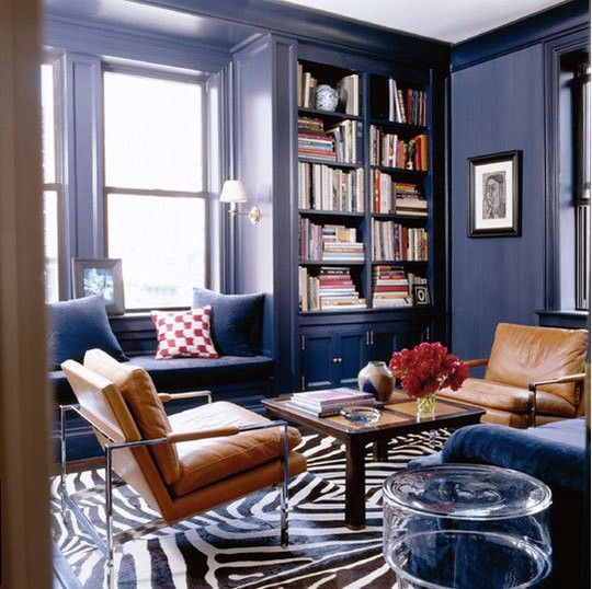 24-navy-space-with-tan-leather-chairs-a-brown-coffee-table