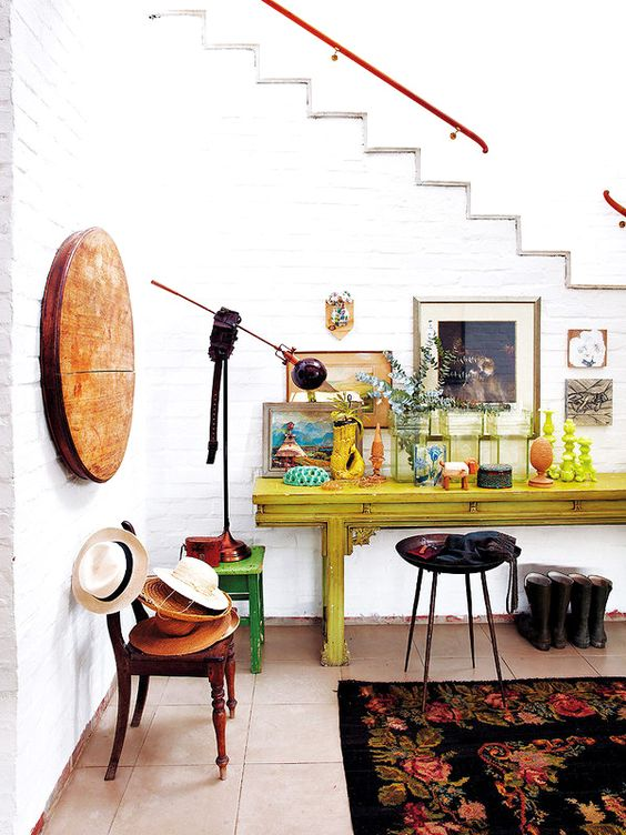 26-eclectic-mudroom-with-white-brick-walls-and-bold-furniture