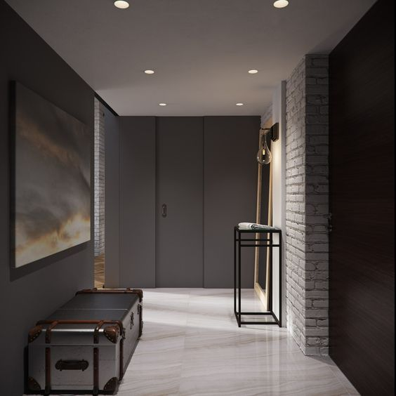 27-dark-walls-and-white-brick-create-a-contrast-in-this-modern-entryway