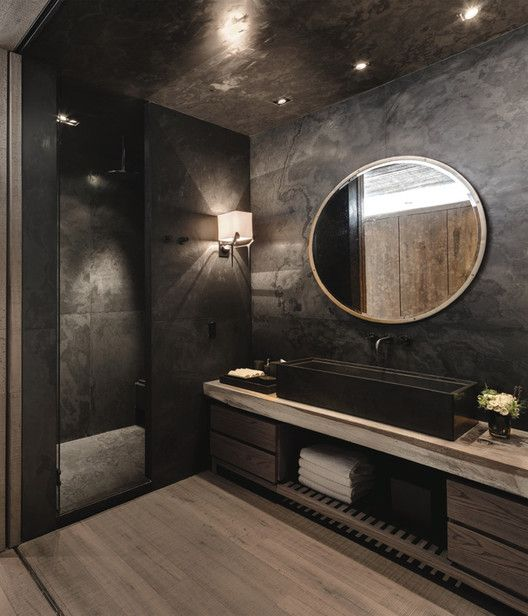 28-moody-bathroom-with-a-huge-sink-wooden-floor-and-cabinets