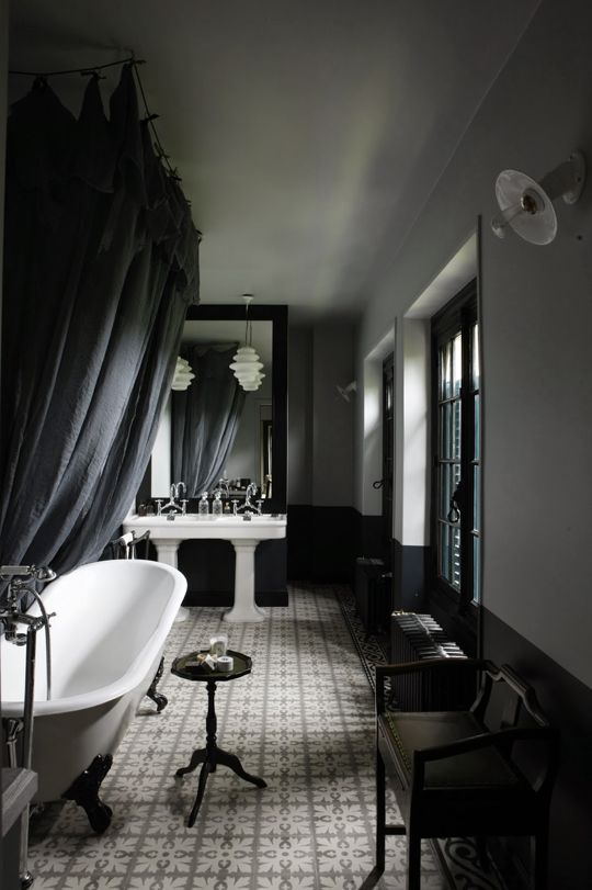 29-moody-vintage-bathroom-with-white-sinks-and-a-bathtub-vintage-furniture-makes-up-the-space