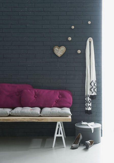 30-black-brick-wall-made-up-with-wall-panels-decorated-with-wooden-pieces