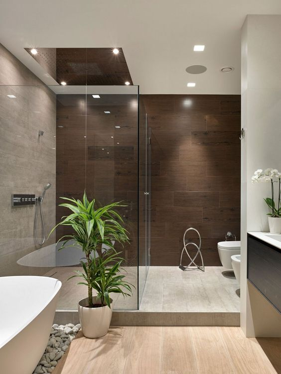 30-potted-greenery-and-orchids-add-a-chic-Japanese-feel-to-this-modern-bathroom