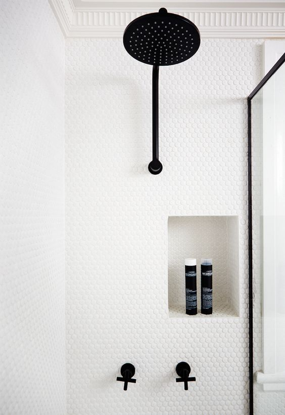 30-white-penny-tiles-contrast-with-black-fittings