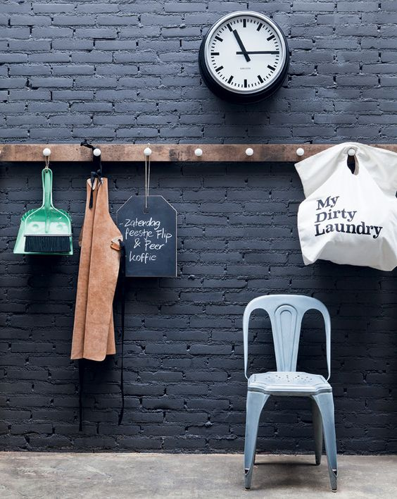 31-black-brick-wall-with-a-wooden-organizer-and-holder