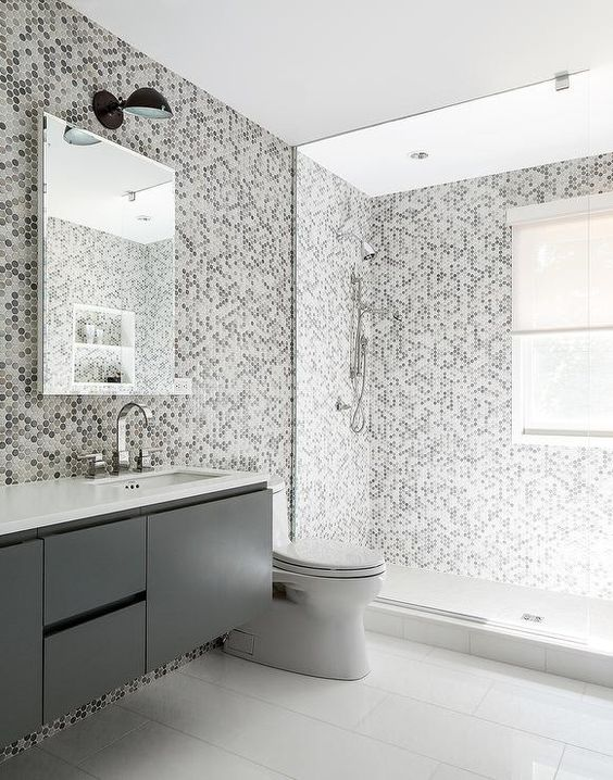 32-gray-kids-bathroom-features-grey-hex-tiles-on-the-wall-and-they-continue-to-the-shower
