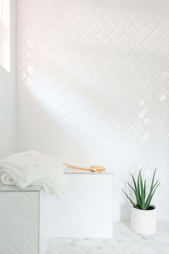 33-simple-subway-tiles-with-white-grout-in-a-herringbone-pattern-in-the-shower