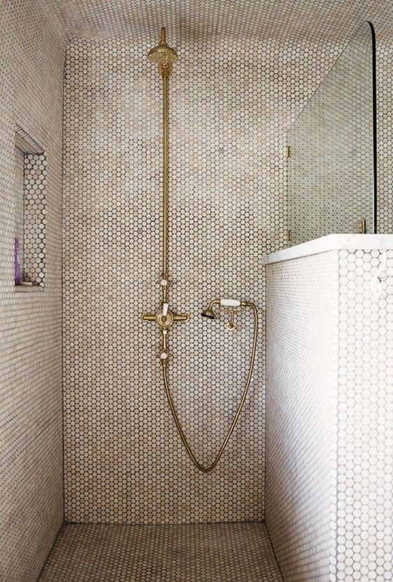 34-shower-with-creamy-penny-tiles-touches-of-marble-and-brass-fixtures