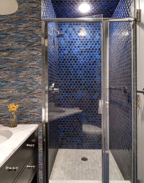 35-to-add-color-to-the-shower-the-designers-used-cobalt-blue-glazed-hexagonal-tiles