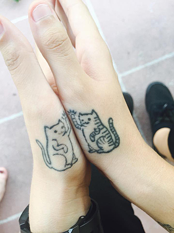 minimalistic-cat-tattoo-53__605-58065736eaaab__605