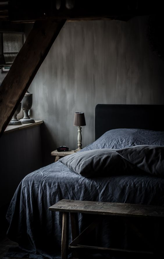 moody-bedroom-with-textural-walls-and-vintage-finds-from-a-flea-market