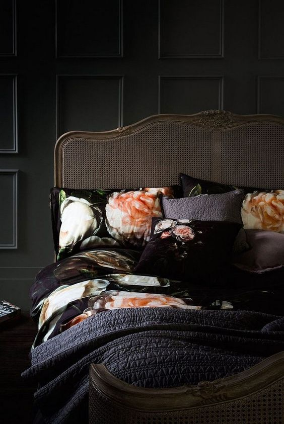 refined-black-bedroom-with-an-antique-bed-and-floral-bedding