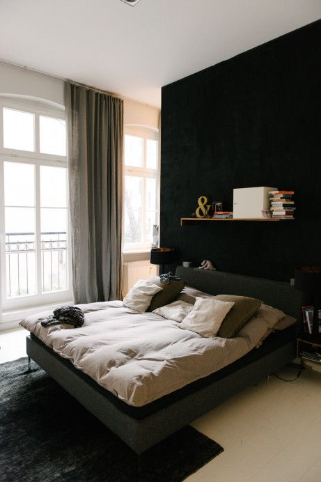 this-bedroom-isnt-that-dark-but-definitely-moody-cause-of-a-black-headboard-wall-and-a-black-carpet