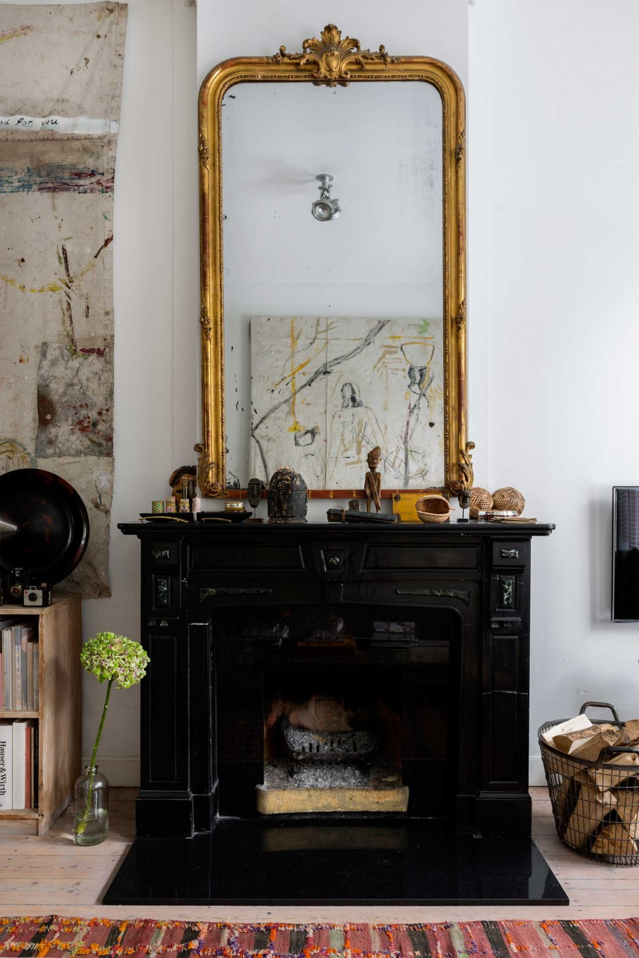 02-Every-space-in-the-house-has-a-black-vintage-fireplace-with-an-oversized-mirror