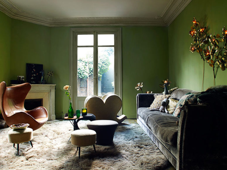 02-The-living-room-is-done-in-green-there-are-flower-and-leaf-shaped-lamps-faux-fur-and-velvet-bold-chairs-775x581
