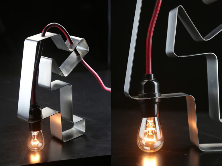 02-The-piece-is-made-of-stainless-steel-and-a-red-cord-with-a-bulb-it-features-industrial-design-775x582