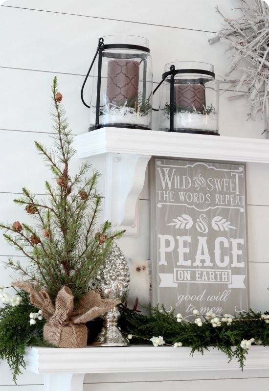 02-a-burlap-wrapped-small-tree-with-an-evergreen-garland