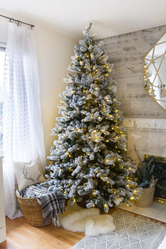 02-a-flocked-tree-decorated-with-only-lights-for-those-who-want-maximize-natural-look