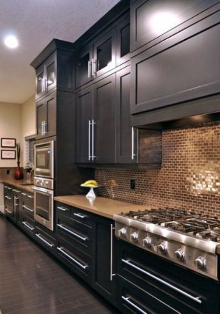 02-black-kitchen-with-copper-tile-backsplash-looks-bold-and-chic