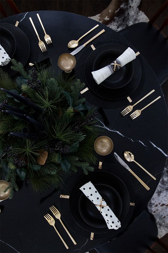02-black-tablescape-with-moody-evergreens-and-black-candles