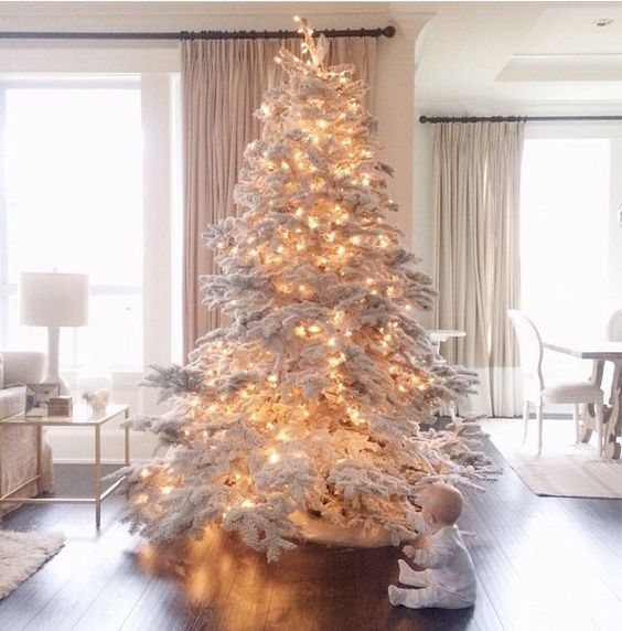 03-a-large-flocked-tree-with-lights-you-dont-need-any-ornaments
