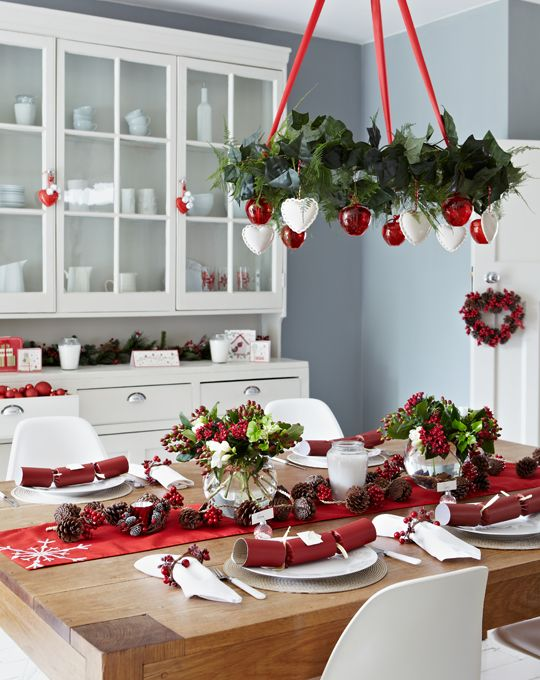 03-a-red-and-white-Christmas-chandelier-a-red-table-runner-and-berries-for-decor