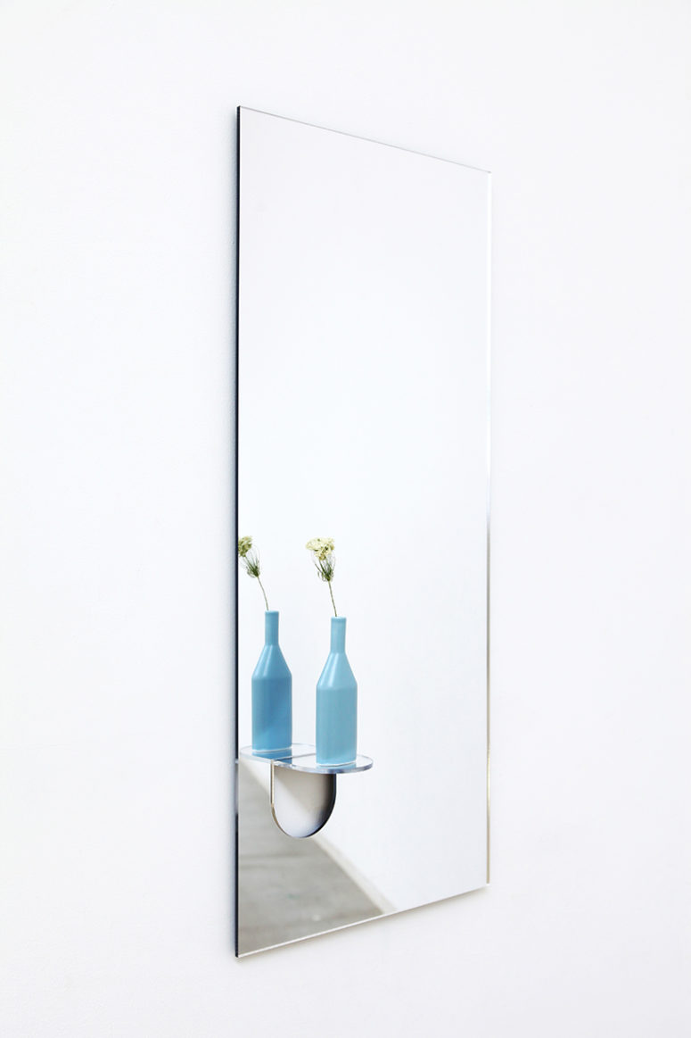 04-The-cute-flap-extends-up-and-out-of-the-glass-creating-a-little-ledge-in-the-face-of-mirror-775x1163