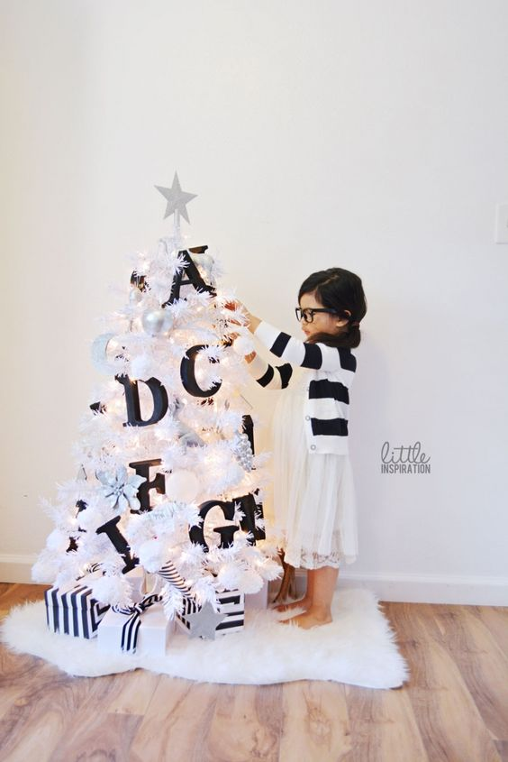 04-a-small-white-tree-decorated-with-black-letters-will-help-your-kids-learn-them