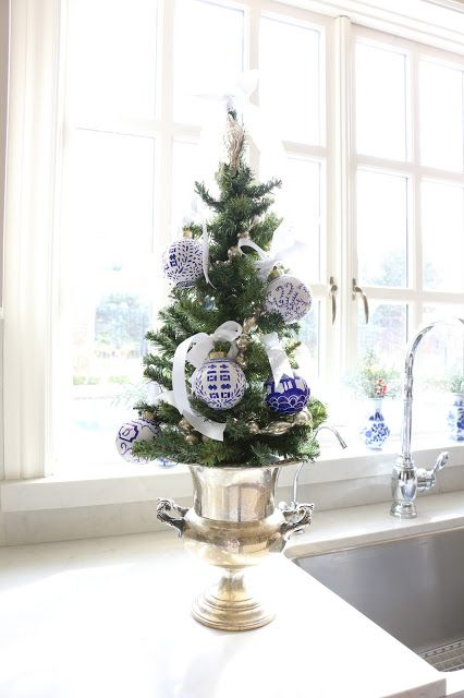 04-a-tabletop-tree-placed-in-a-gold-urn-with-blue-and-white-ornaments