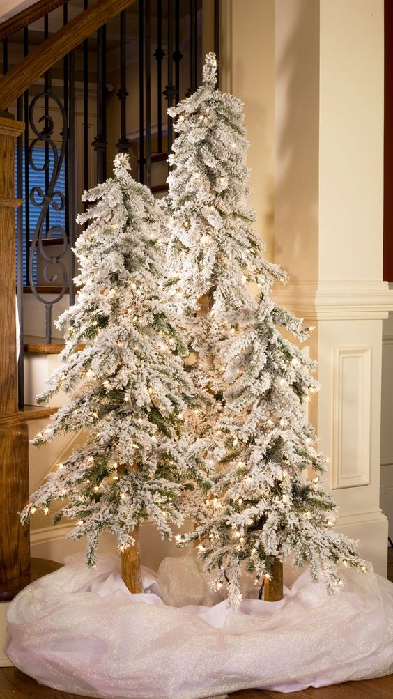 04-flocked-tree-trio-with-lights-and-white-fabric-to-cover-and-imitate-snow