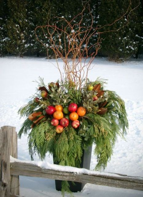 05-a-container-with-greens-branches-leaves-and-colorful-faux-apples