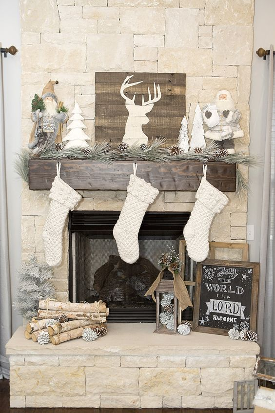 06-rustic-mantel-with-pinecones-and-wood-logs-white-stockings-and-a-barnwood-sign-to-refresh-the-look